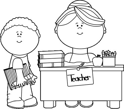 Black and White Boy Student at Teacheru0026#39;s Desk