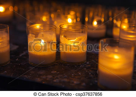 Church candles in transparent chandeliers - csp37637856