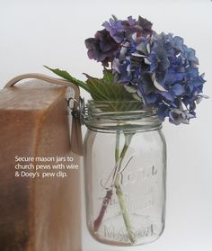 Church Pew Decoration Inspiration: Mason jar filled with fresh flowers. Ribbon, twine or lace can be added to dress plain jars.