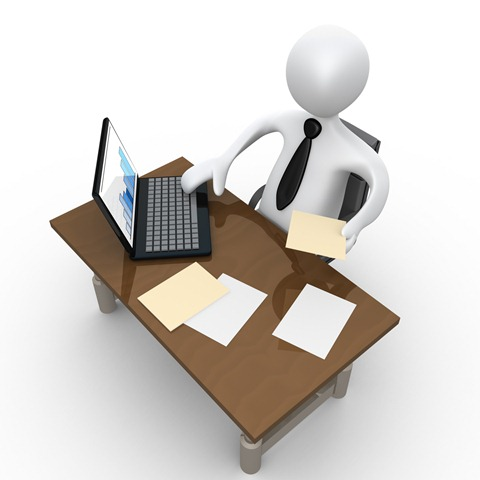 Clipart Illustration Of A White Employee Seated At A Wooden Desk And