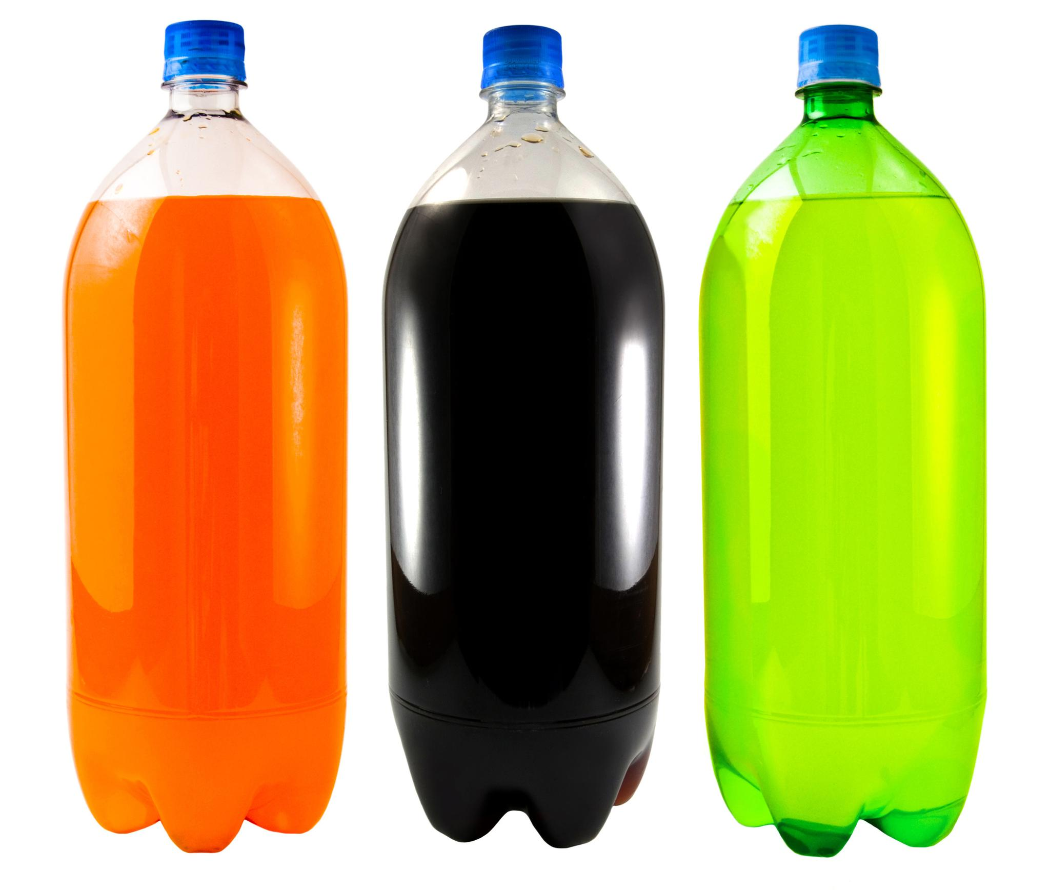 Close Up On Three Soda Bottles Isolated On A White Background The