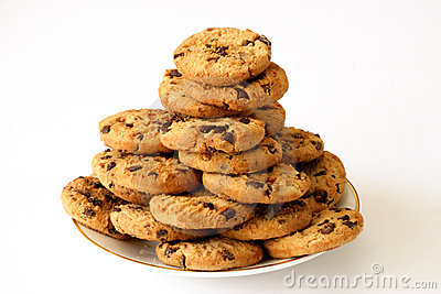 Cookies on a plate aganist a white background.