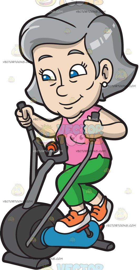 A Mature Woman Riding An Elliptical Trai-A Mature Woman Riding An Elliptical Trainer-4