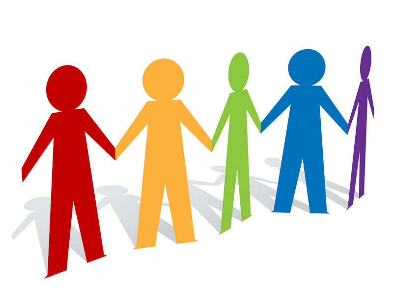 Group of people holding hands .