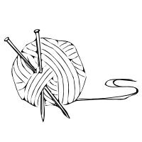 knitting needles in a ball of yarn