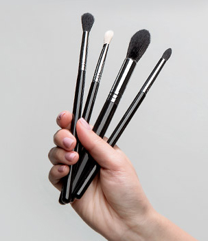Woman holding makeup brushes ClipartLook.com