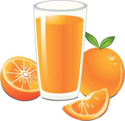 of orange juice in a glass .