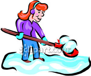 Woman Using A Snow Shovel .
